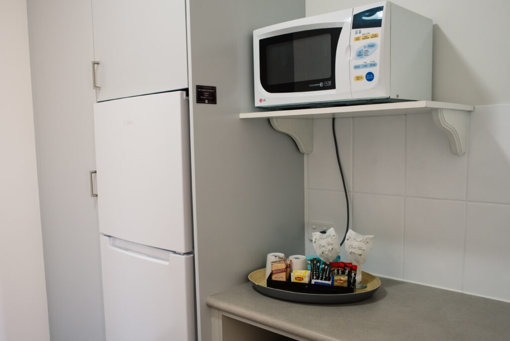 The Heritage Bendigo Motel fridge, microwave, kettle, and tea and coffee
